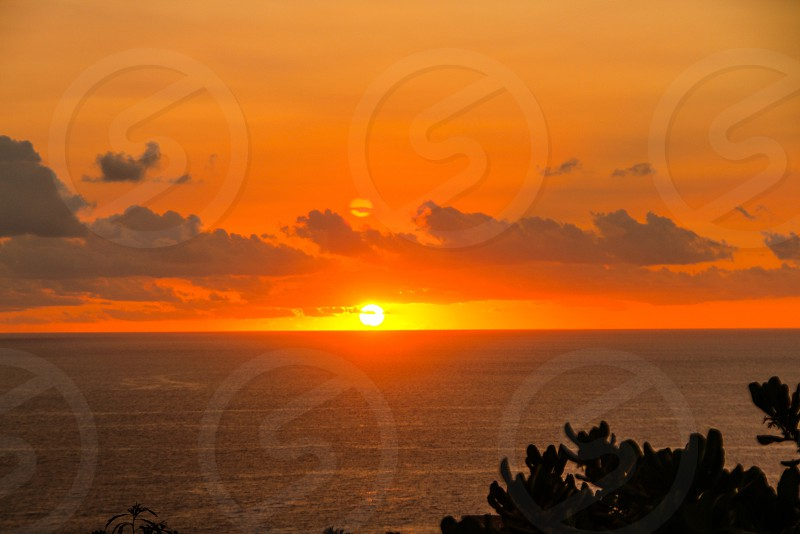Golden red sunset over the ocean photo