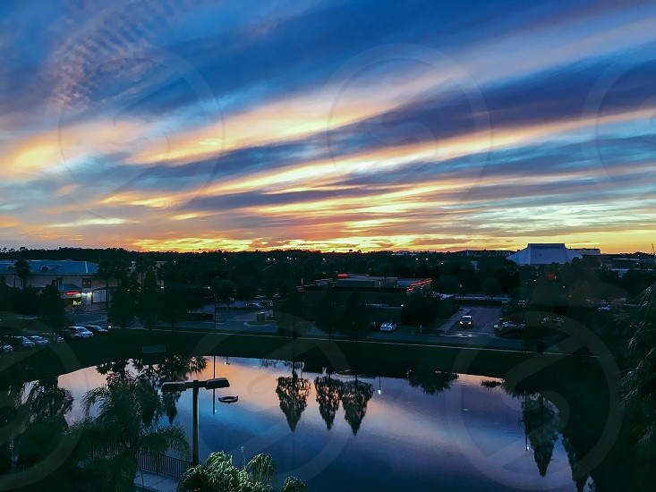 Orlando hotel birds eye view looking down sunset vivid reflection trees photo