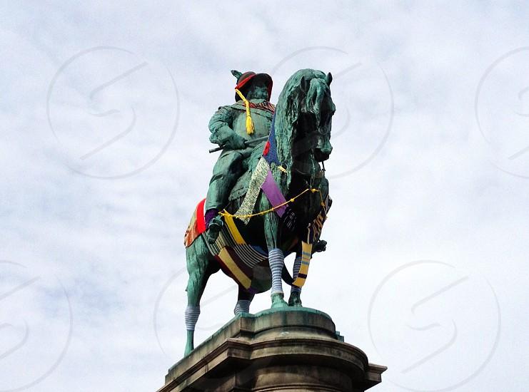 green man riding horse statue photo