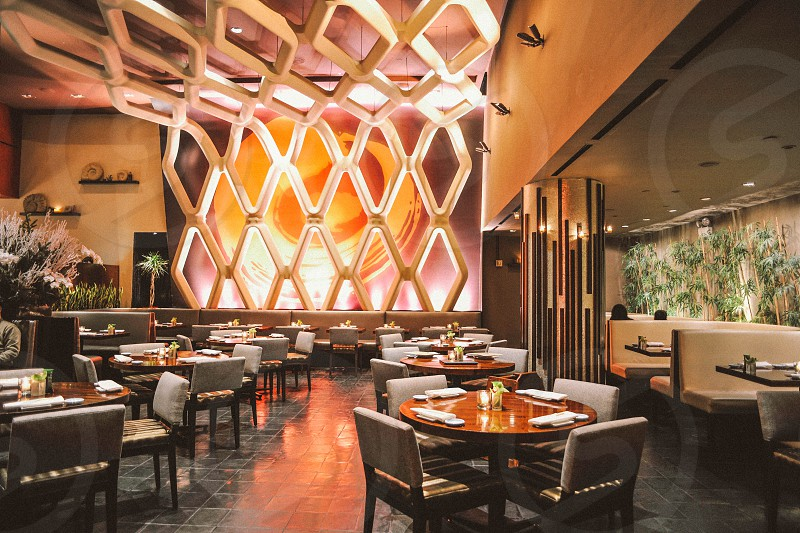 interior restaurant view with tables chairs and booths and a diamond decorative wall photo