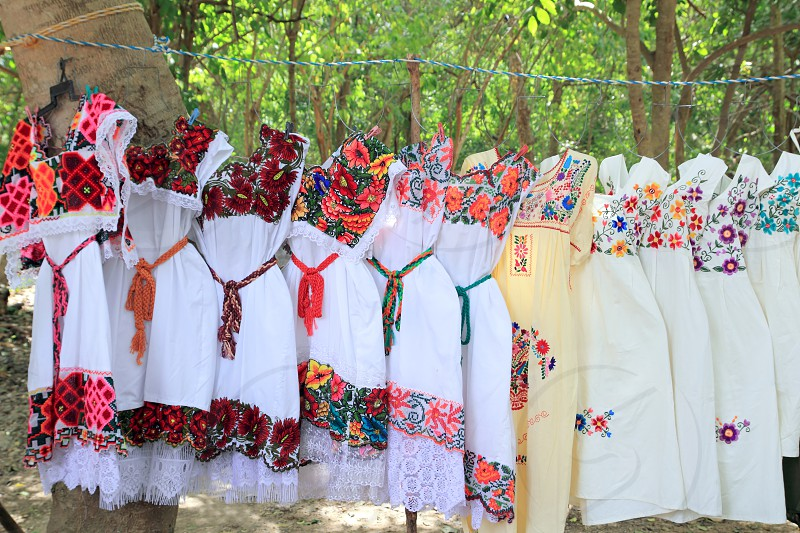 Mayan woman dress with embroid flowers from Yucatan Mexico photo
