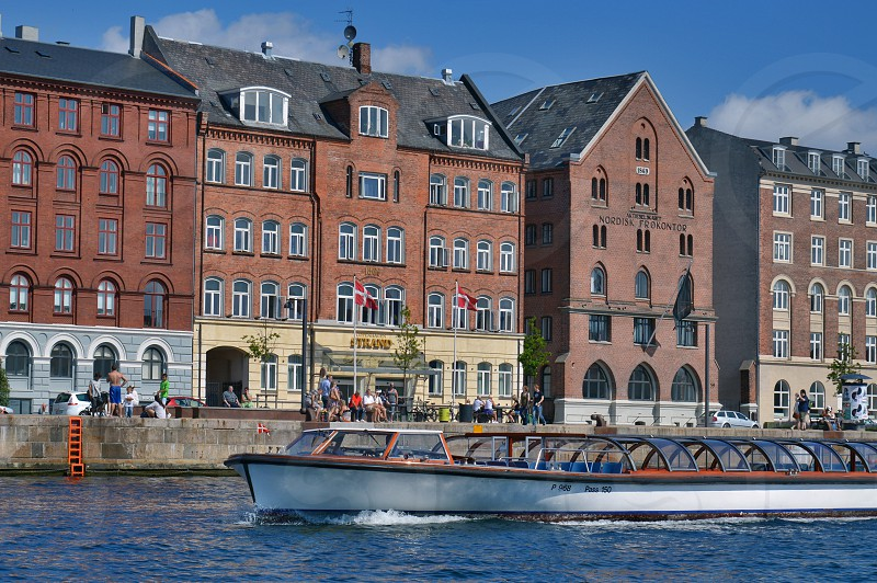 copenhagen denmark cruise canal boat people tourist tour europe nyhavn travel port tourism landmark old water city couple european architecture view building harbour cityscape ship autumn yacht waterfront kanal frederiksholms summer scandinavia quay landscape harbor boats urban scenery exterior town historic history historical capital vintage ancient heritage church cathedral hall photo