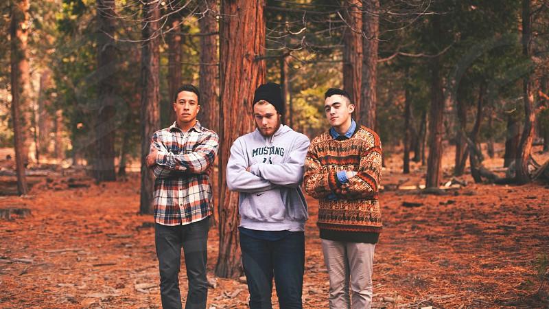 three men standing photo