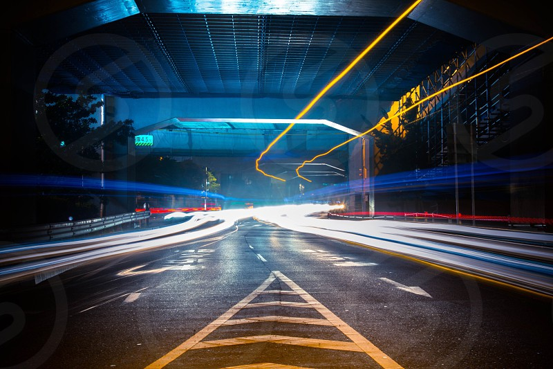 long exposure photography of vehicle's trail lights on the road during nighttime photo