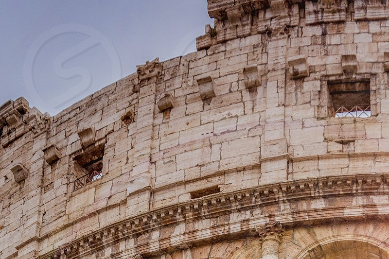 architectural detail of the colosseum in Rome photo