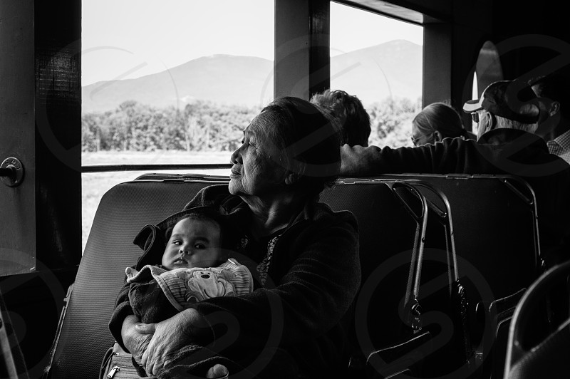 Traveler on a train with her baby in Maine. photo