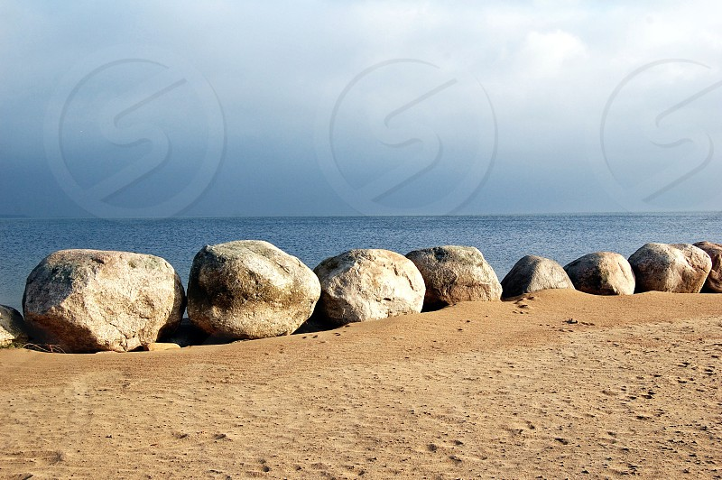 assorted boulders on a beach photo