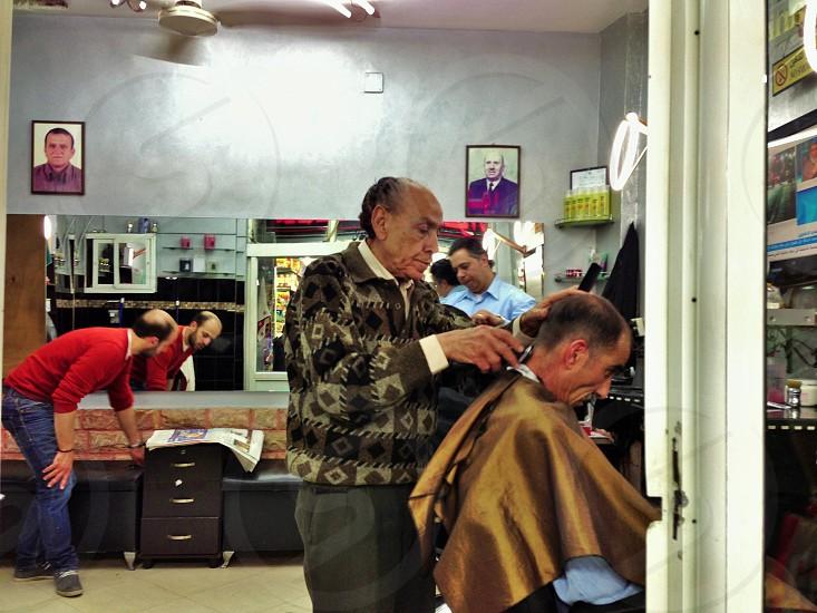 man cutting a hair photo