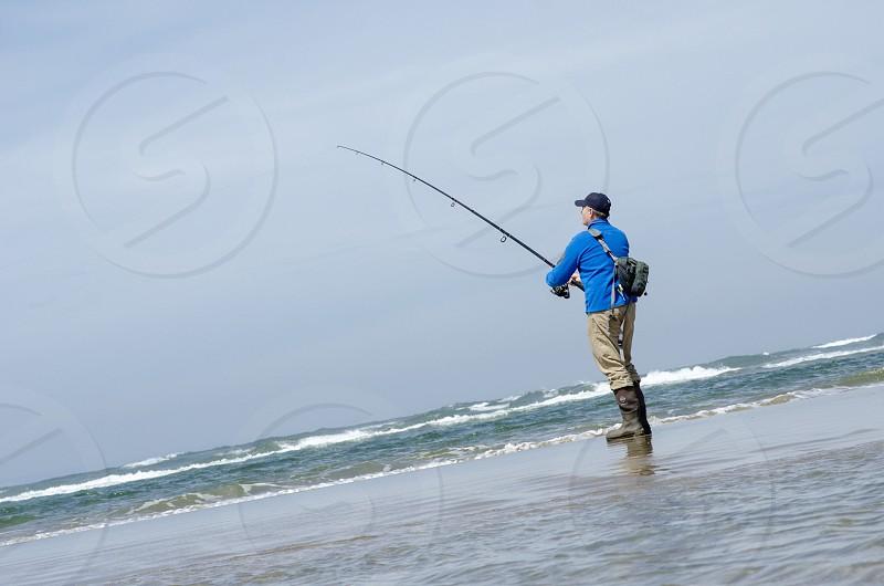 Fishing ocean surf perch photo