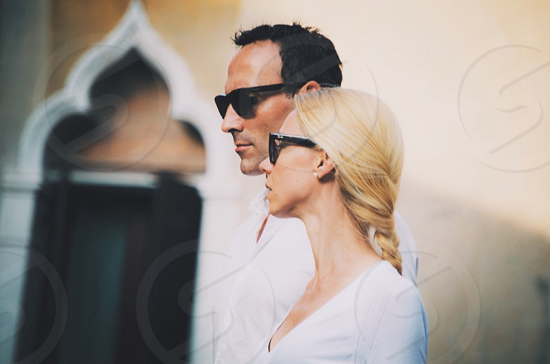 woman in v neck long sleeve shirt and man in white dress shirt wearing black sunglasses in tilt shift lens photo