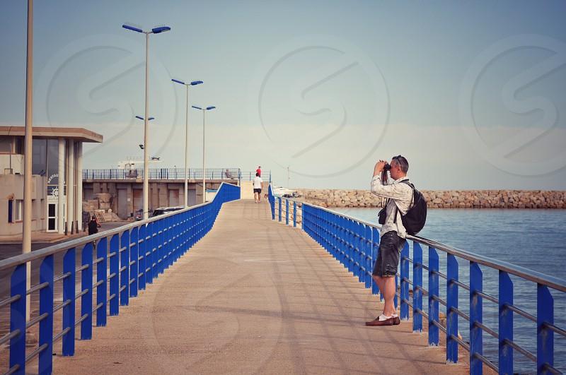 Men watching in the binoculars on the sea photo