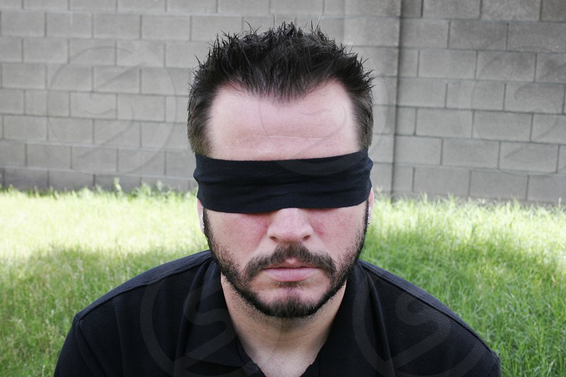 Man Blindfolded Outdoors photo