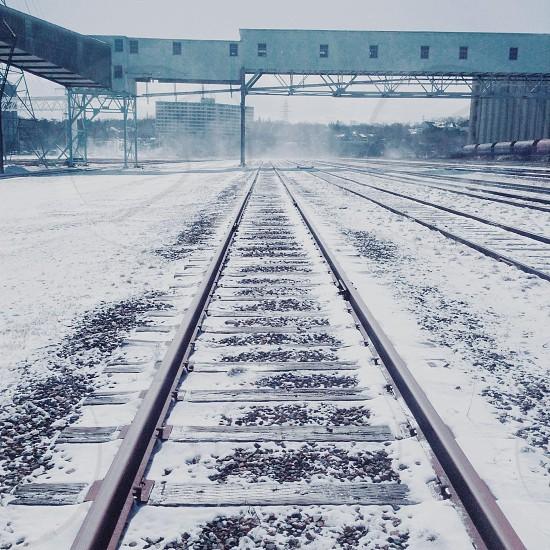 snow covered railroad tracks photo