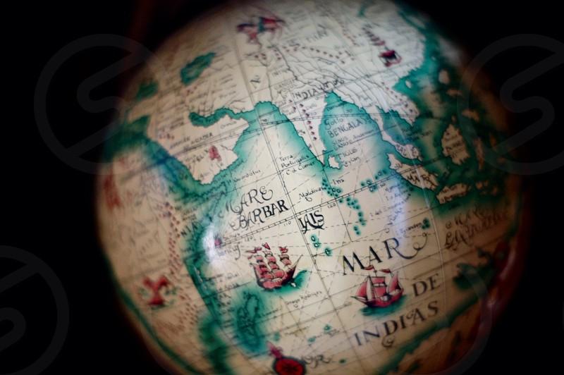 gray green black  mar de indias globe map photo