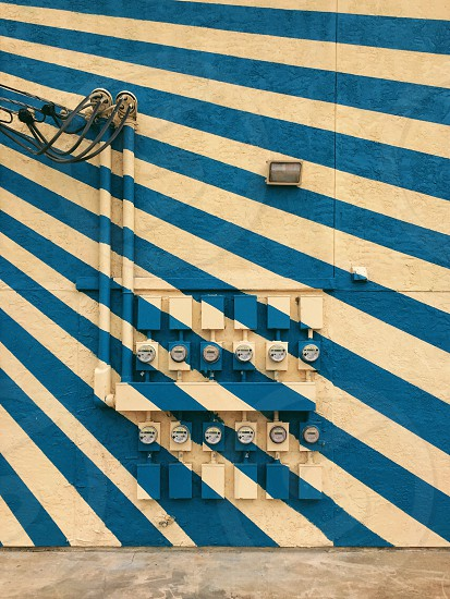 electric meters on blue and white stripe wall photo