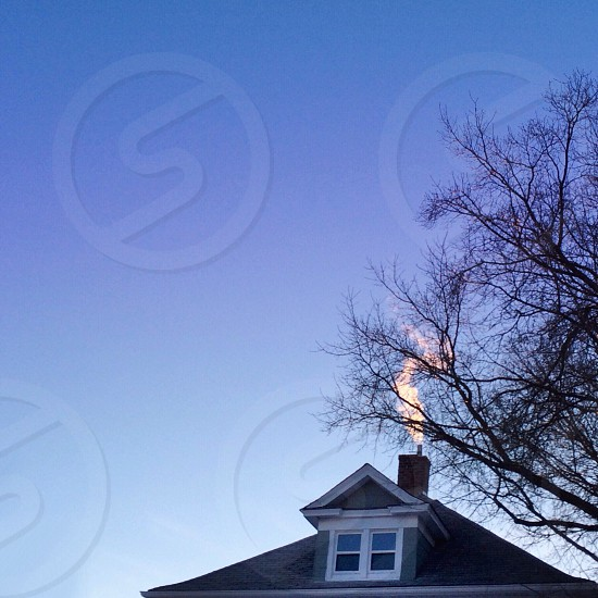 view of the smoke on the house's chimney photo