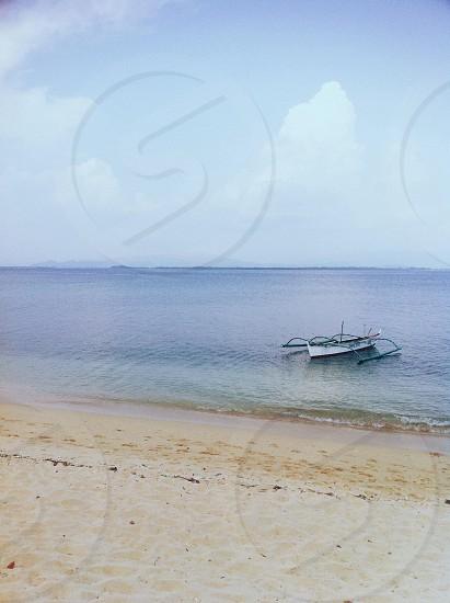 white boat near sea shore photo