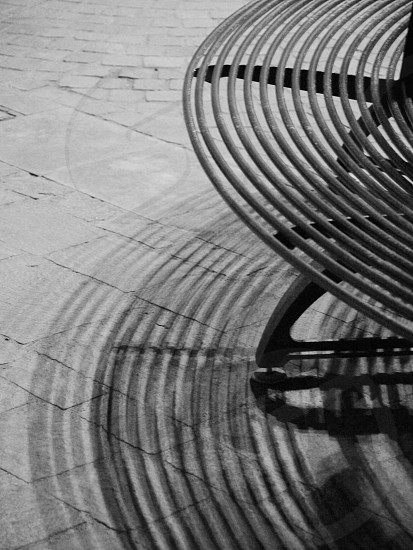 bench circular shadows black white photo