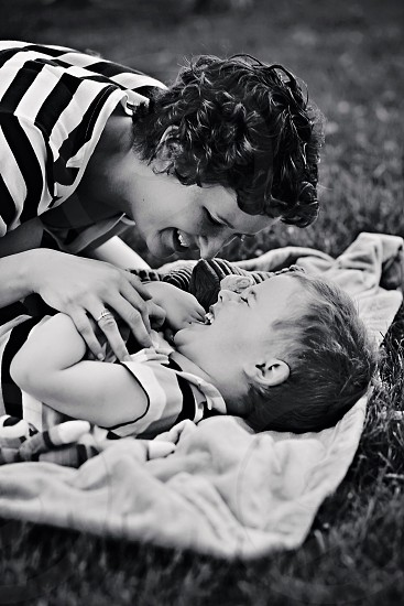 woman playing with boy photo