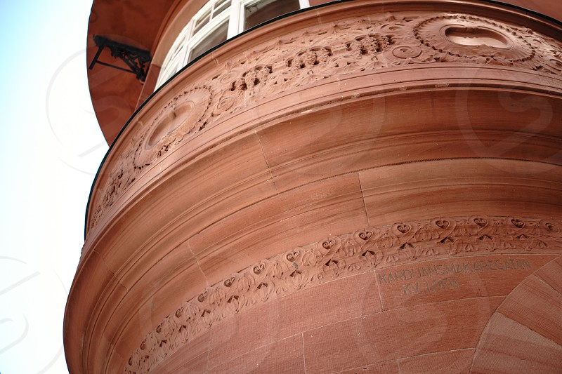 brown painted circular structure building photo