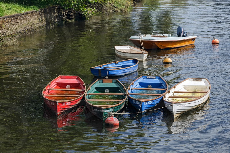 Group of Rowing Boats Full with Rainwater photo