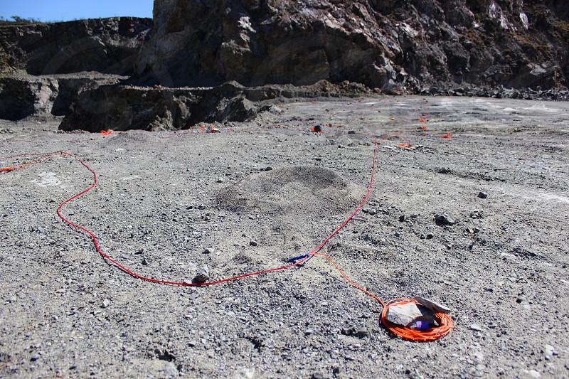 fuse and detonators in blasting rock quarry photo