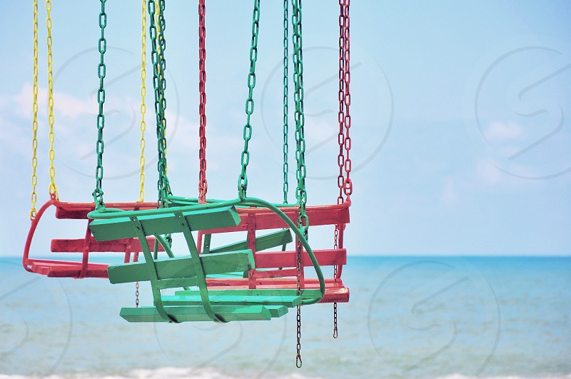 one green and 2 pink swings photo
