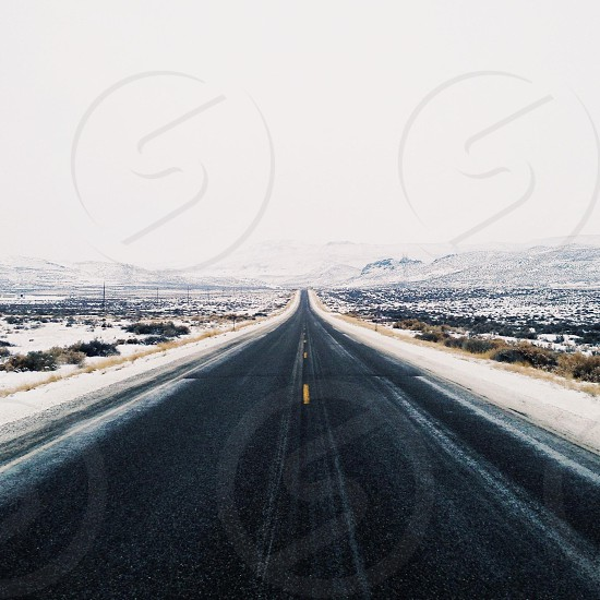 An open road and a thin shawl of snow... photo