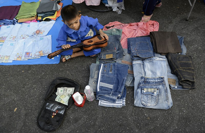a boy at a market street at the Santichaiprakan Park at the Mae Nam Chao Phraya River in the city of Bangkok in Thailand in Southeastasia. photo