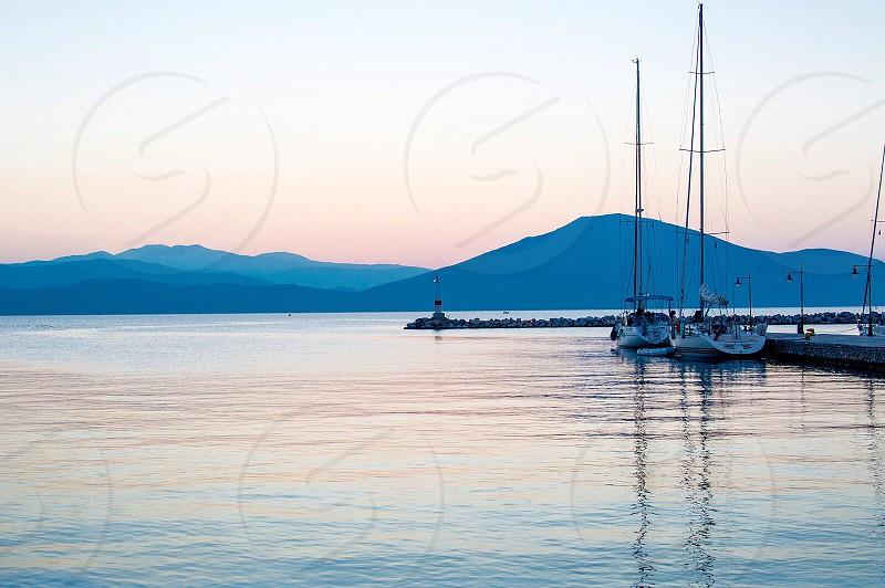 Travel summer Europe Greece sea water blue boat dawn lighthouse Aegean photo
