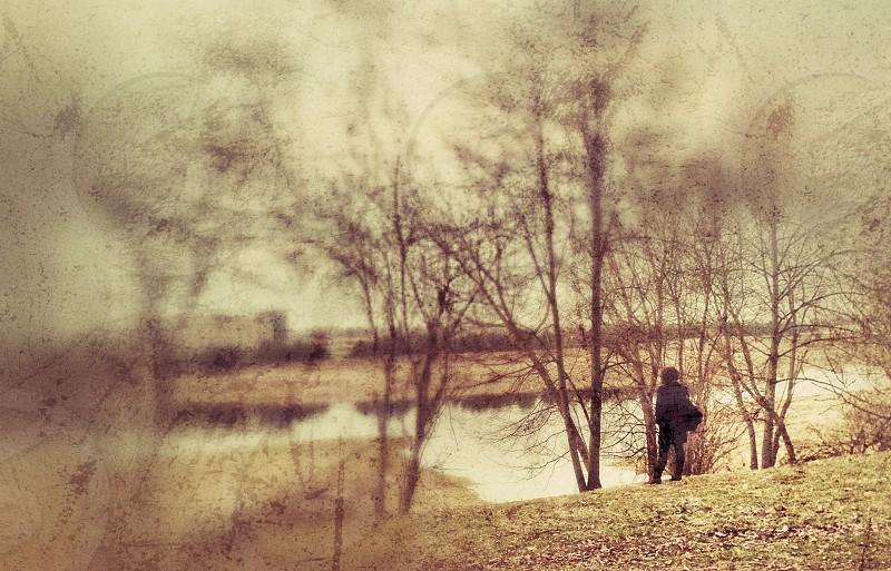 person near lake motion blur photography  photo