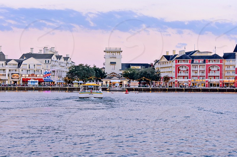 Orlando Florida. February 09 2019. Colorful Dockside waterfront panoramic view on cloudy sunset background at Lake Buena Vista area (1) photo