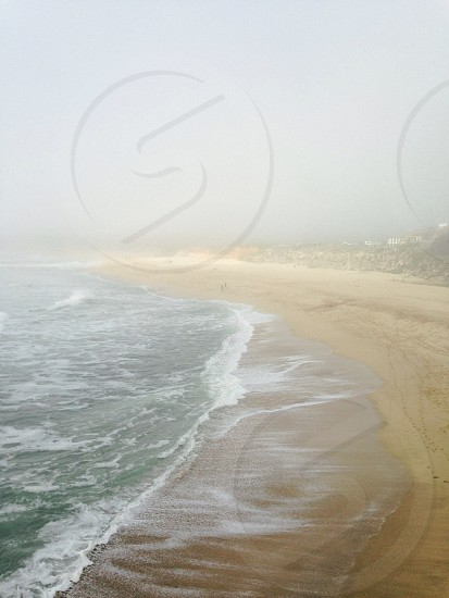 white water waves on shore photo