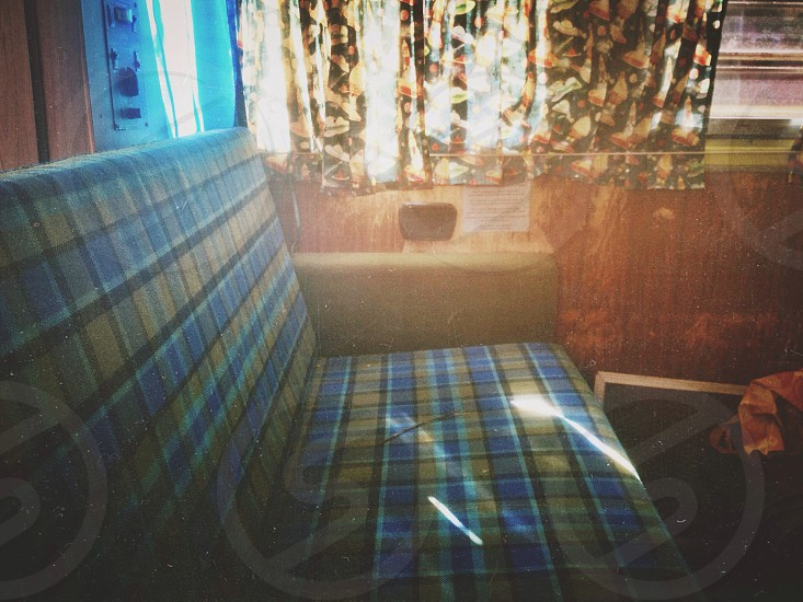 blue and brown plaid lounge chair photo