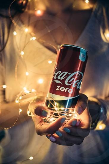coca-cola in woman hands photo