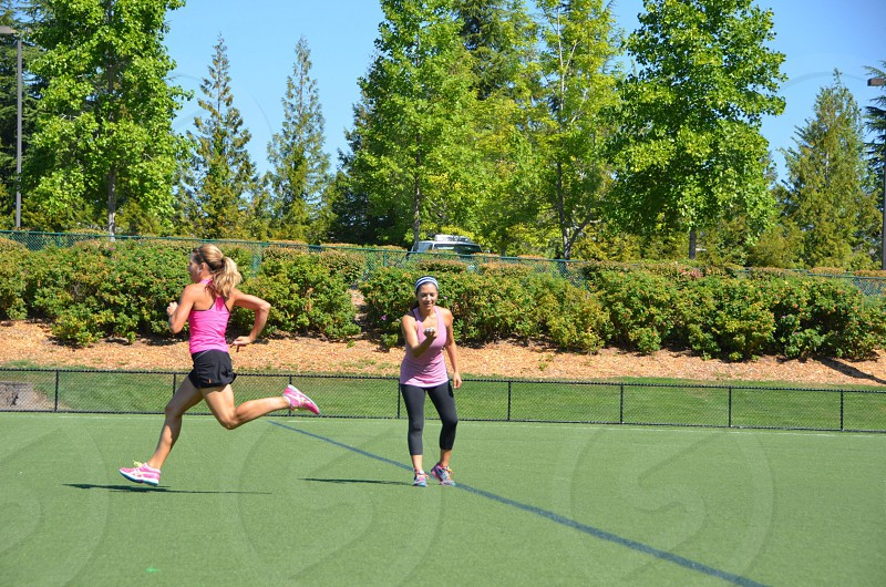 Trainer female athletic training running sprinting timing health photo