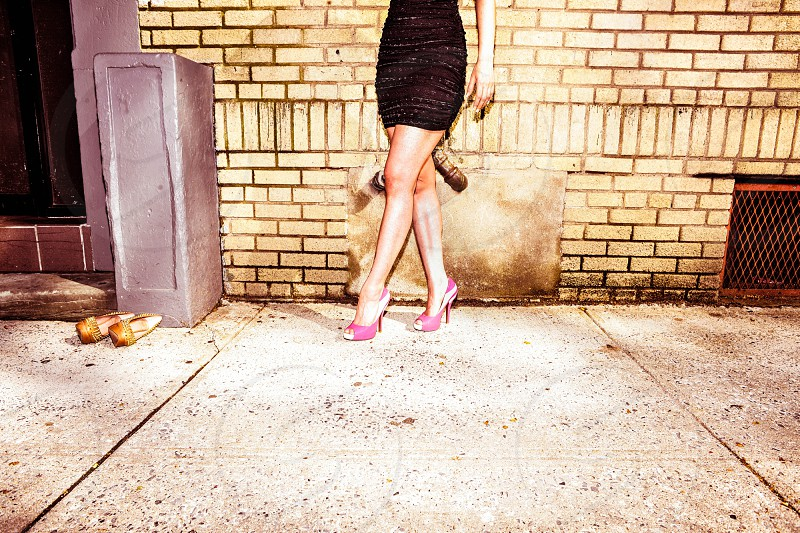 woman black dress legs sequence pink heels shoes photo