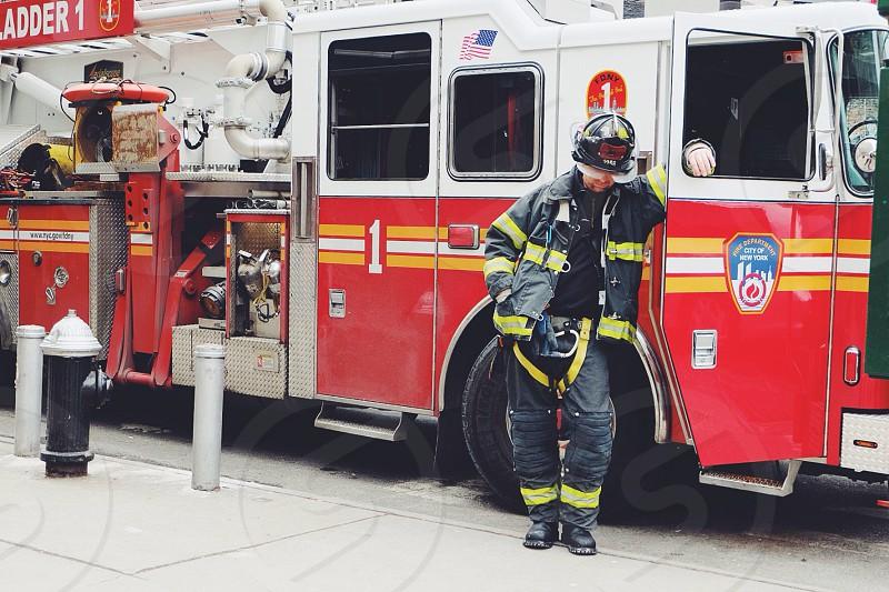 fireman standing beside fire truck photo