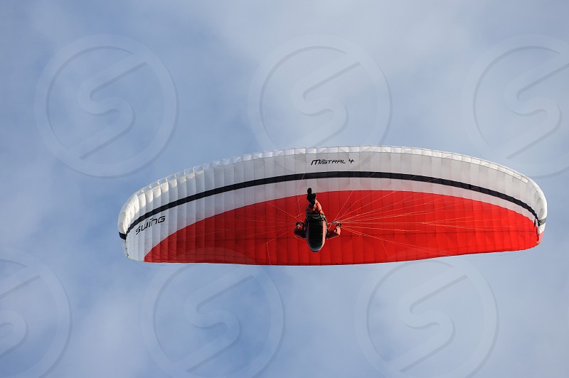 man in red and white parachute photo