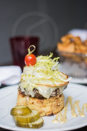 close-up selective focus photography of sandwich with sauce shredded lettuce and red cherry on top photo
