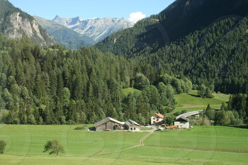 Swiss countryside from Glacier Express train. Switzerland.  photo