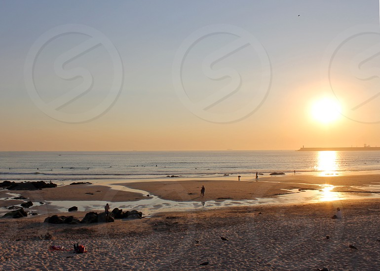 Portugal Porto ocean sand beach sunset sun photo