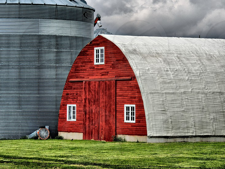 Red sloping side barn and silo photo