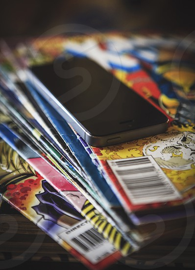 Some comics and an iPhone.  photo