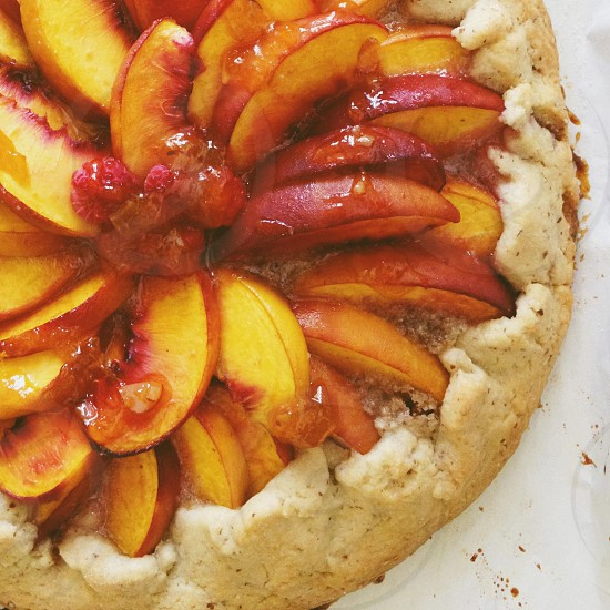 peach pie with raspberry accent photo