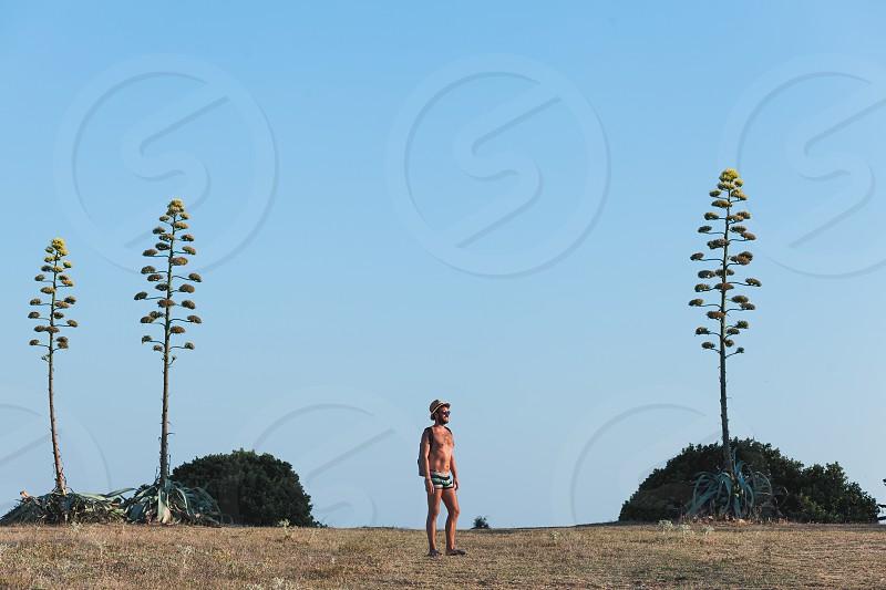 Young male traveler exploring coastline photo