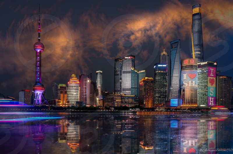 Shanghai skyline seen from across the Hunagpu River from the city Bund offers an exquisite view. Always wanted to take a shot that made the buildings appear as close as they feel in real life. Thank you for stopping by. You can also see my work at: https://500px.com/ash_photos https://www.instagram.com/AshTG_Photos https://www.flickr.com/photos/ashwanibhasin https://www.facebook.com/AshPhotoPics  photo