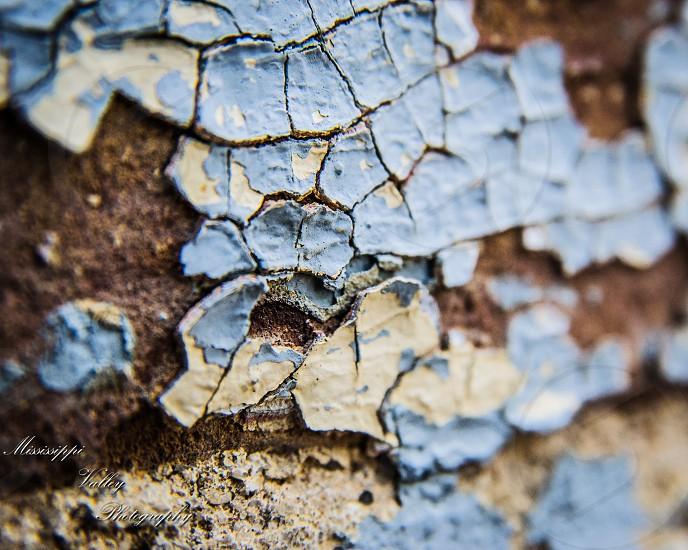 Peeling paint brick and mortar photo