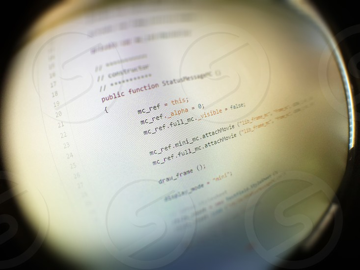 fisheye lens focusing on programming language text photo