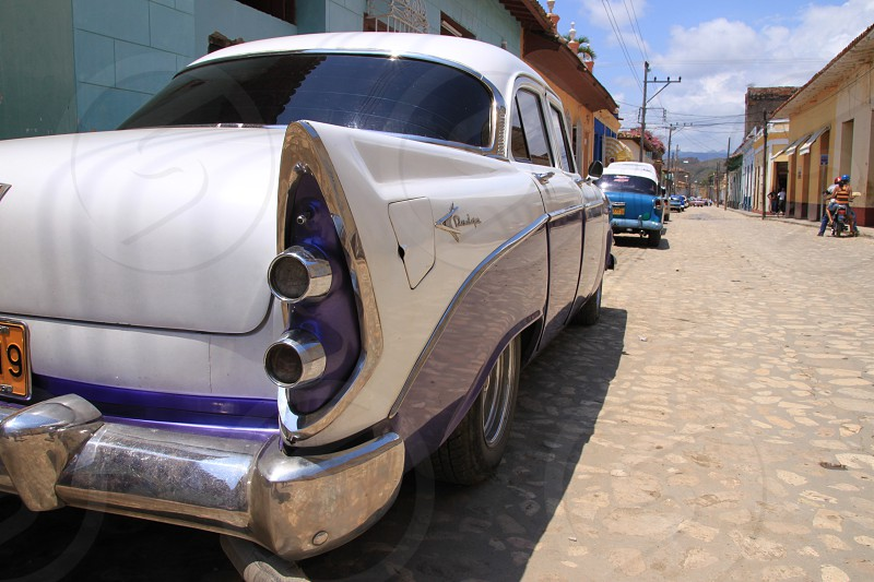 white classic vintage car parked photo
